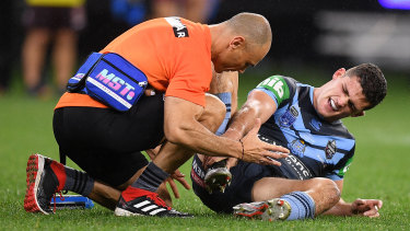 Nathan Cleary receives treatment during the first half of Origin II.
