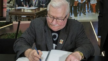 Lech Walesa, the former Polish democracy activist and ex-president, signs a condolence book for Gdansk Mayor Pawel Adamowicz.