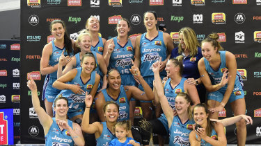 Southside Flyers celebrate after their 2020 WNBL grand final victory.