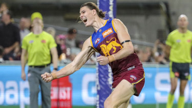 Hip hooray: Brisbane forward Eric Hipwood celebrates after bagging five goals for the Lions in a match-winning performance against the Demons.