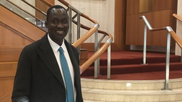 Queensland African Communities Council president Beny Bol at Parliament House.