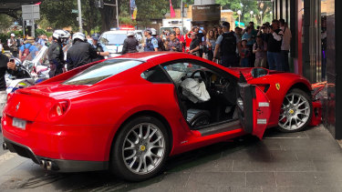 The red Ferrari skidded into the window of Ole Lynggaard Copenhagen about 3.25pm.
