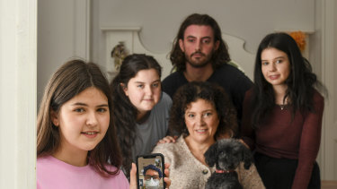 Nicole Cullinan, her 4 children from LEFT TO RIGHT Sophie 19 years old, Faith 16 years old, Tom, 21 years old, Bella 23 years old and dog Frenchie at their Melbourne home