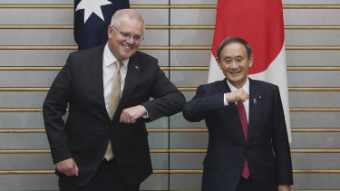 Australian Prime Minister Scott Morrison poses with Japanese Prime Minister Yoshihide Suga at the start of their meeting at Suga's official residence in Tokyo.