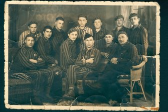 Phillip (at top row, far left) with the Balingen garage crew in May 1945, shortly after liberation and still wearing their prison camp uniforms.