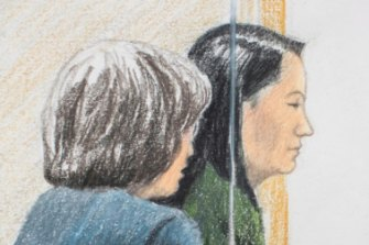 Meng Wanzhou, right, sits beside a translator during a bail hearing at British Columbia Supreme Court in Vancouver, on Friday.
