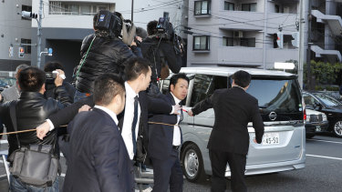 The silver van that was said to be carrying Ghosn.