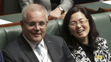 Prime Minister Scott Morrison sits with Liberal Gladys Liu during a division in the House of Representatives.