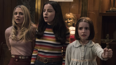 Madison Iseman (left), Katie Sarife and McKenna Grace in Annabelle Comes Home.