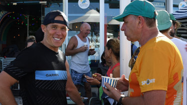 Bondi lifeguard Andrew Reid, left, talks with Chris Edwards, who has run the race every single year since 1971, during a breakfast at Bondi Beach to announce the opening of entries for the 2019 City2Surf.