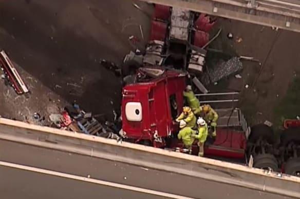 Driver confirmed dead in crash off motorway bridge