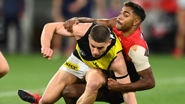 Dion Prestia is tackled by Kysaiah Pickett.