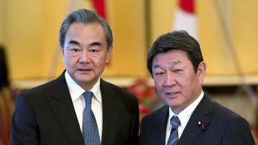 Chinese Foreign Minister Wang Yi (left), poses with his Japanese counterpart Toshimitsu Motegi last year.