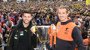 Trent Cotchin and Phil Davis with the Premiership Trophy during the 2019 AFL grand final parade in Melbourne.