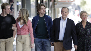 Opposition Leader Bill Shorten with wife Chloe, son Rupert (centre) and daughter Georgette with her boyfriend Pat (left) arrive during a visit to the Salvation Army's Lighthouse Cafe in Melbourne on Good Friday.