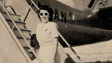 Qantas hostess Patricia Burke arrives for work in summer uniform, 1948.