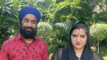 Manmeet Kour Bali, right, with her second husband in a photo provided by Manjinder Singh Sirsa, head of the largest gurudwara, or Sikh temple, in New Delhi.