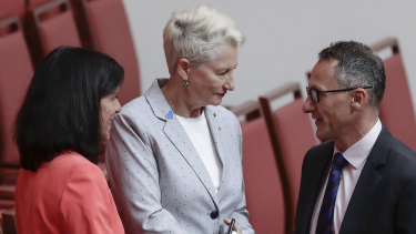 Crossbench MPs Julia Banks and Kerryn Phelps shake hands with Greens leader Richard Di Natale after the Senate agreed on House's amendments to its amendments to the Home Affairs Legislation Amendment Bill.