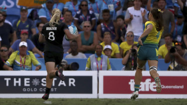 The clincher: Kelly Brazier runs away from Australia's Dom Du Toit to score the match-winning try in extra time of the women's sevens final.