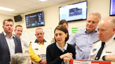 Prime Minister Scott Morrison and Premier Gladys Berejiklian, talking the volunteers inside the Wollondilly unit emergency fire control centre.
