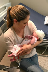 Jane McQualter cradles baby Emily in the early weeks.