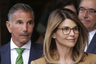 Lori Loughlin (right) and husband Mossimo Giannulli (left) depart a federal court.