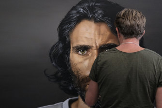 Archibald Prize finalist Angus McDonald with Behrouz Boochani's Resistance, which he says is a portrait of the refugee's unshakeable resolve.