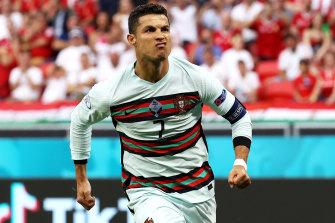 Cristiano Ronaldo celebrates scoring Portugal's second goal in Budapest.
