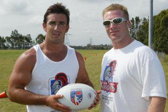 Andrew Johns receiving a New York Knights singlet and ball from Matt Astill in 2003.