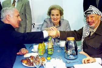 Albright's gender was of no issue to Middle Eastern leaders, enabling her to hold talks with the likes of Israeli PM Benjamin Netanyahu, left, and Palestinian president Yasser Arafat in 1998.