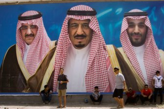 A billboard showing King Salman, centre, his son Mohammed bin Salman, right, and former designated heir Mohammed bin Nayef in Taif, Saudi Arabia.