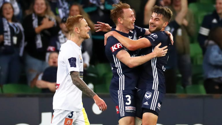 On target: Victory's Corey Brown (centre) celebrates with team mate Terry Antonis (right) after scoring a goal as Jack Clisby of the Mariners looks on during the round 4 match at AAMI Park in Melbourne.