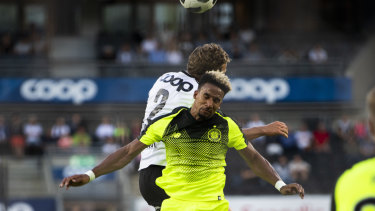 Honours even: Scott Sinclair, front, challenges for the ball with Vegar Eggen Hedenstad.