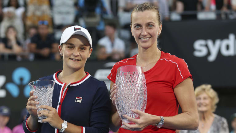 Glassware: Kvitova holds the winner's trophy alongside runner-up Barty and her consolation prize.