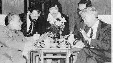 """Mr Hawke, who swore off tobacco last Christmas, refuses a cigarette from chain-smoking Mr Deng at their meeting"""