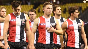 Despondent St Kilda players leave the field after another defeat.