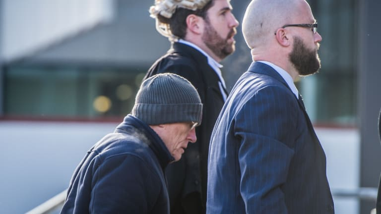 David Eastman, left, arrives at the ACT Supreme Court with his lawyers for his trial earlier this year.