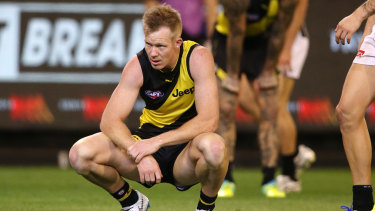 Cause for concern: Tigers forward holds his sore wrist after the siren sounds.