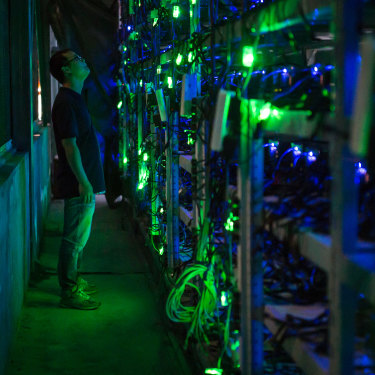 A manager checks equipment in a bitcoin mine in Sichuan, China.