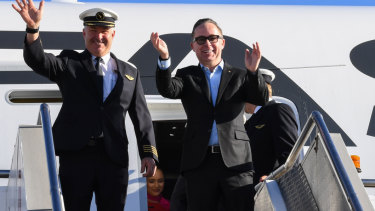 Qantas CEO Alan Joyce (right) and Captain Sean Golding (left) stepping off the airline's non-stop flight from New York to Sydney on Sunday.
