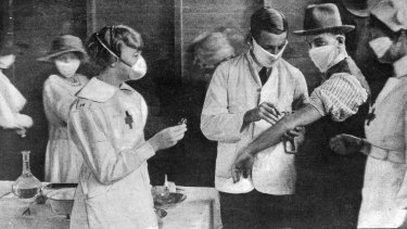 Inoculation at a special depot in Hyde Park at the height of the 1918-1919 flu epidemic in Sydney.