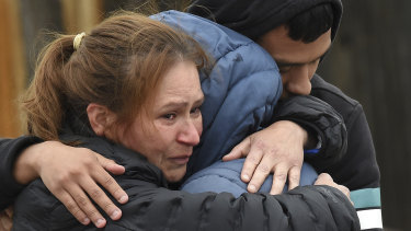 Family members mourn at the scene where their loved ones were killed in Colorado Springs, Colorado.