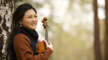 Emily Sun seems to breathe as one with pianist Andrea Lam in their expressive collaboration.
