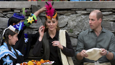 Members of Kalash community greet the royals with traditional caps during their visit to Pakistan's northern Chitral district.