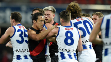Tempers fray: Essendon's Dylan Shiel (left) gets involved in some push and shove with North Melbourne players during their round 6 clash.