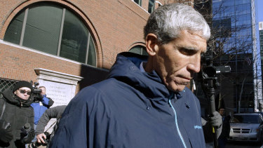 """William """"Rick"""" Singer, founder of the Edge College & Career Network, departs federal court in Boston on Tuesday after he pleaded guilty to charges in a nationwide college admissions bribery scandal."""