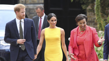 Baroness Scotland with Prince Harry and Meghan Markle.
