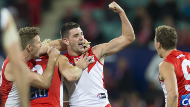 Cheer, cheer: The Swans celebrate Colin O'Riordan's first AFL goal during a drought-breaking win on Friday night.