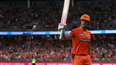Top notch: Mitchell Marsh of the Scorchers salutes the crowd after scoring 93 not out against Brisbane Heat at Optus Stadium in Perth.