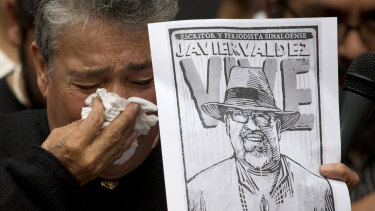 A mother who became active in the search for Mexico's missing after four of her sons disappeared, weeps after speaking about murdered journalist Javier Valdez during a protest against the killing of reporters in Mexico City in 2017.